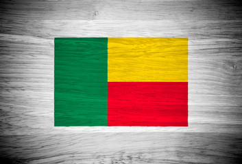 Benin flag on wood texture