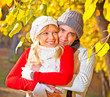 Happy couple in fall under leaves of a broad leaved lime.