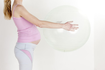 detail of pregnant woman doing exercises