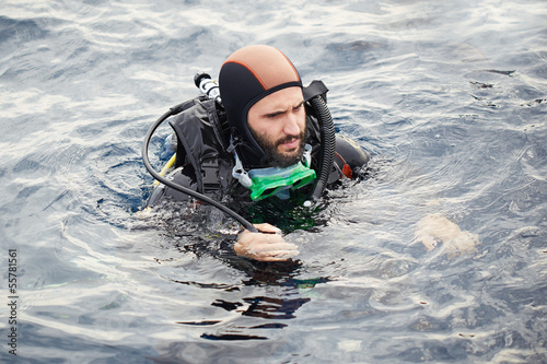 Young man scuba diving