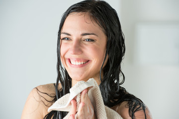 Sexy woman wiping herself with towel