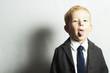 funny little boy in suit.style kid. fashion children.joy