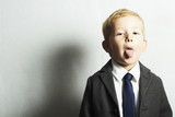 funny little boy in suit.style kid. fashion children.joy