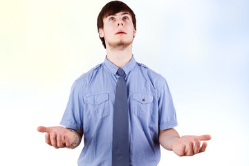 Young businessman with open hands