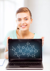 girl holding laptop with network contacts