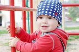 smiling baby age of 10 months on playground