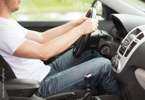 man driving the car with manual gearbox