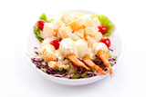 delicious salad of vegetables and prawns with sauce
