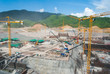 Huge construction site for dam with cranes in mountain area - 55787166