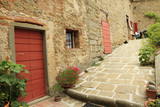 stonewall with front doors in quiet medieval tuscan village