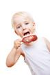 canvas print picture - Junge isst ein Eis am Stiel