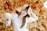beautiful woman wearing straw hat