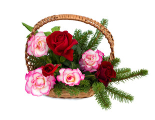 bouquet of roses are in a wicker basket