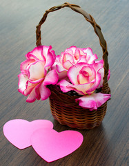 bouquet of roses is in a wicker basket