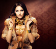 Beauty Fashion Model Girl in Fox Fur Coat