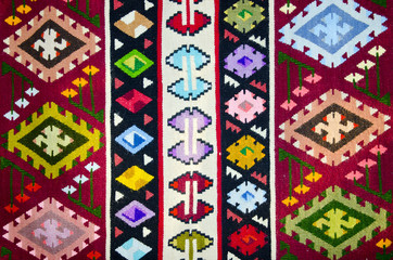 Old traditional romanian wool carpet with ancient motifs