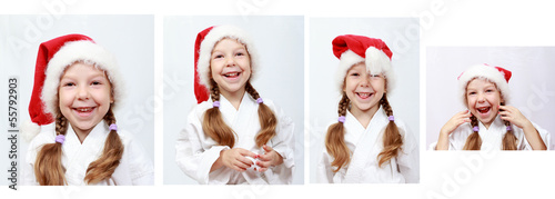 Cheerful little girl with Santa Claus beanie on his head