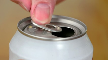 Opening a can of soda using a pull-tab