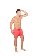 Handsome lifeguard with red swimsuit
