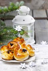 Traditional swedish buns in christmas setting. A saffron bun