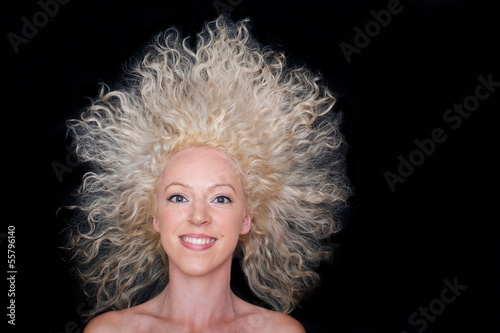 beautiful wild hair girl on black background