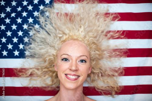 pretty wild hair woman on American flag