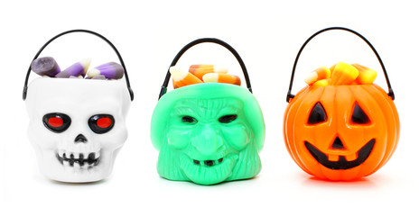 Three types of Halloween candy holders filled with candy corn