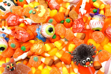 Full background of an assortment of Halloween candy