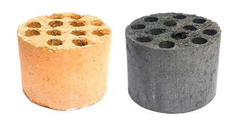 used and new coal briquette on a white background