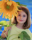 Girl and sunflower in the garden