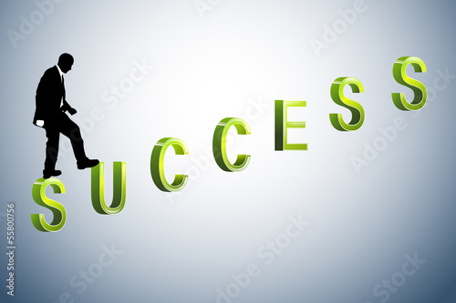 Image of a businessman standing on the success letter
