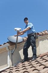Satellite Installer on Roof.