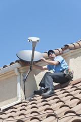 Satellite Installer on Roof 2.