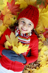 Autumn fun - girl playing in autumn leaves