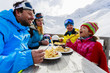 Winter - skiers enjoying lunch in winter mountains
