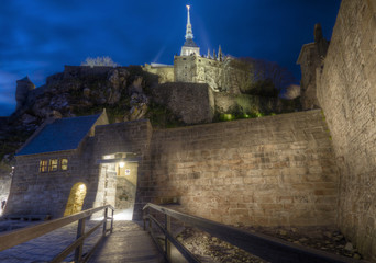 Small bridge at night with Mont Saint Michel