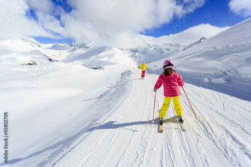 Skiing, winter, ski lesson - skiers on ski run