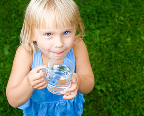 Child with cap of water