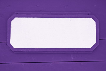 Wooden signboard on Purple planks background