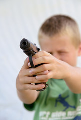Boy shoots a gun