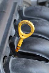 Engine oil dip stick in a car