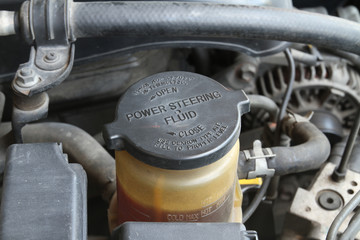 Power steering fluid cap with warning label in a car