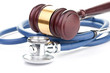 brown gavel and a medical stethoscope