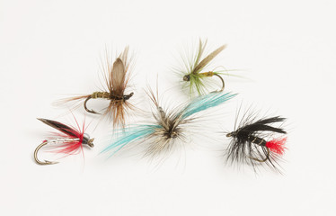 Selection of hand tied fishing flies on white