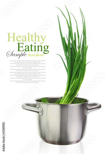 Fresh green onions in a stainless steel cooking pot