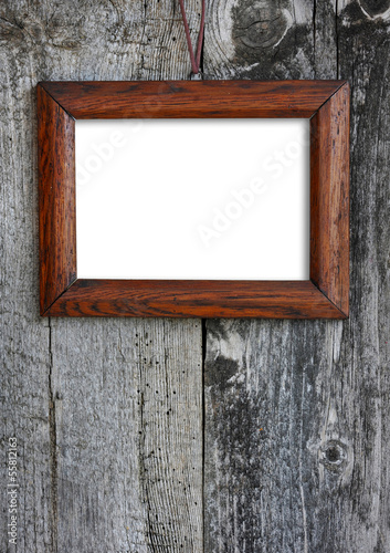 Old wooden frame on a old wooden wall