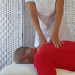 Deep tissue trigger point therapy to upper back