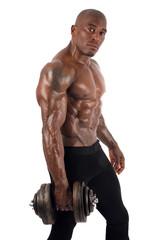 Black bodybuilder training with dumbbells. Strong man