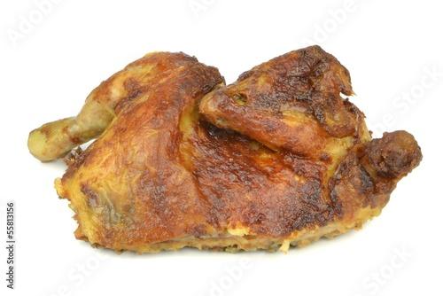 Half a grilled chicken on a white background
