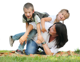 Funny family playing on the grass against a white background.
